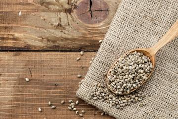 hemp seeds on a muslin cloth on a wooden worktop