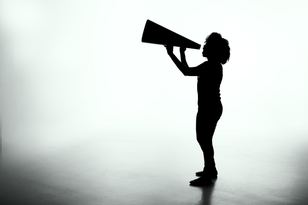 silhouette of lady holding a megaphone