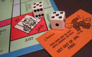 Monopoly board with dice and Chance Card